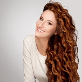 Red Hair. Woman with Beautiful Curly Hair